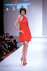 Tamara Taylor wearing Mark Belford – Heart and Stroke Foundation - The Heart Truth celebrity fashion show - Red Dress - Red Gown - Thursday February 8, 2012 - Creative Commons.jpg
