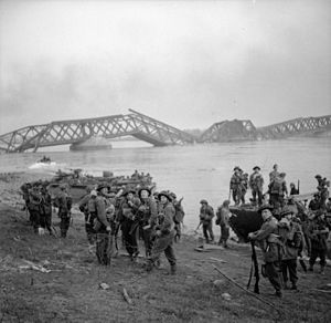 115th Brigade (United Kingdom) - Men of the 1st Battalion, Cheshire Regiment crossing the Rhine in Buffaloes at Wesel, Germany, 24 March 1945.