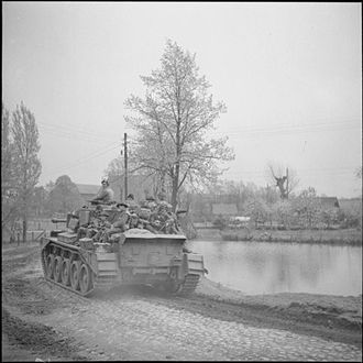 Herefordshire Light Infantry - Comet tank of the 3rd Royal Tank Regiment carrying infantrymen of the 1st Battalion, Herefordshire Regiment, Germany, 2 May 1945.