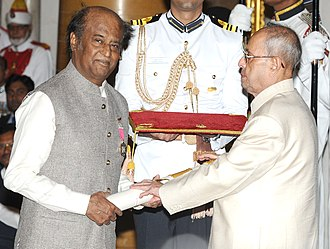Rajinikanth - President Pranab Mukherjee presenting the Padma Vibhushan to Rajinikanth at Rashtrapati Bhavan, New Delhi on 12 April 2016