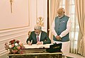 The President of the Republic of Armenia, Mr. Serzh Sargsyan signing the visitors' book, at Hyderabad House, in New Delhi on November 03, 2017. The Prime Minister, Shri Narendra Modi is also seen.jpg