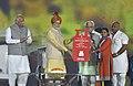 The Prime Minister, Shri Narendra Modi distributing the LPG connections to the beneficiaries to mark recognition of 8 districts as Kerosene-free in Haryana, at Haryana Swarna Jayanti Celebrations, in Gurugram, Haryana (1).jpg