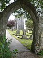 The footpath from Dane Lane goes through this arch and enters the churchyard of St. Michael and All Angels, Hartlip - geograph.org.uk - 1296578.jpg