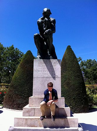 The Thinker - The Thinker and a man imitating the pose