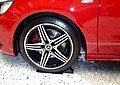 The tire wheel of red Mercedes-Benz A 250 SPORT 4MATIC (W176).jpg