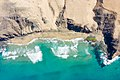 Top-down areal of the famous surfing spot Playa del Viejo Reyes in la Pared on Fuerteventura.jpg