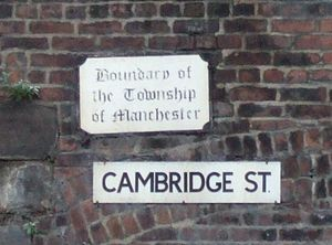 Manchester city centre - One of the boundary signs of the former township of Manchester on the banks of the Medlock