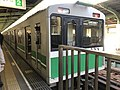 Train for Cosmosquare Station at Bentencho Station.jpg