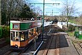 Tram waiting at Colyford, with the level crossing beyond (geograph 5719378).jpg