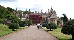 Tyntesfield - View of the approach to the house from the west via the visitors centre, effectively to the rear of the property. Architect John Norton designed an irregular roof to emphasise the asymmetrical design. This picture was taken in September 2005, before the restoration of the roof and its distinct diaper-pattern.