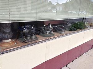 "Woodstock, Illinois - Typewriters in a Woodstock business' window in 2013. Note the name ""Woodstock"" on some of them."