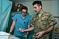 U.S. Air Force Senior Airman Jon Paul Fitzgerald, right, a medic assigned to the 455th Emergency Medical Group, shows Army Sgt. Jenna Moffitt, a truck commander assigned to the 110th Transportation Company 140902-A-CA521-002.jpg
