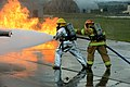U.S. Air Force firefighters suppress fires during a training exercise on a concrete pad known as a burn pad at Spangdahlem Air Base, Germany, Jan. 8, 2014 140108-F-OP138-154.jpg