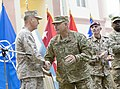 U.S. Army Gen. John F. Campbell, center, shakes hands with Marine Corps Gen. Joseph F. Dunford Jr 140826-D-HU462-617.jpg