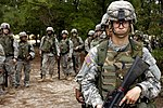U.S. Army privates wait their turn to go through the convoy live-fire course during Army basic training at Fort Jackson, September 2006.jpg