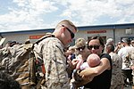 U.S. Marine Corps Capt. Trevor Tingle, left, a pilot with Marine Heavy Helicopter Squadron (HMH) 466, meets his infant son for the first time upon returning to Marine Corps Air Station Miramar, Calif., Aug. 23 120823-M-XW721-020.jpg