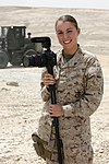 U.S. Marine Corps Cpl. Ashley E. Santy, a combat photographer with the 2nd Marine Aircraft Wing (Forward), poses for a photo at Camp Bastion, Helmand province, Afghanistan, Aug. 7, 2013 130807-M-SA716-123.jpg