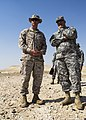 U.S. Marine Corps Lt. Col. Kevin Collins, left, the commanding officer of Combat Logistics Battalion 26, 26th Marine Expeditionary Unit, and Army Maj. Gen. Robert Catalanotti discuss training between U.S 130429-M-HF949-012.jpg