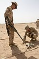 U.S. Marine Corps Sgt. Tyler Byfield, right, a combat engineer squad leader assigned to Battalion Landing Team, 3rd Battalion, 2nd Marine Regiment, 26th Marine Expeditionary Unit, instructs Lance Cpl. Daniel 130609-M-BS001-020.jpg