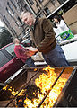U.S. Marine Cpl. Daniel Weber, assigned to Marine Forces Reserve (MARFORRES), warms his hands over the heat provided from the grill during a volunteer event at the Ozanam Homeless Shelter, New Orleans, La 131125-M-IJ438-022.jpg