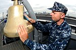 U.S. Navy Aviation Boatswain's Mate (Handling) Airman Christian Odell shines a bell aboard the aircraft carrier USS Ronald Reagan (CVN 76) Aug. 26, 2013, in San Diego 130826-N-HI324-084.jpg