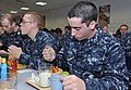 U.S. Navy Seaman Recruit Jonathon Petrie, foreground, eats lunch with fellow recruits inside the USS Triton recruit barracks' galley at Recruit Training Command at Naval Station Great Lakes, Ill 121031-N-IK959-308.jpg
