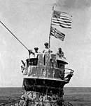 U.S. naval officers on the conning tower of the captured German submarine U-505, in June 1944 (NH 10585).jpg