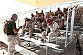 U. S. Navy HM2 Ryan Allen with Headquarters and Service Company, Combat Logistics Regiment 2 (CLR-2), 2nd Marine Logistics Group, instructs the combat lifesaver course to Marines from CLR-2 during Enhanced 120905-M-KS710-005.jpg