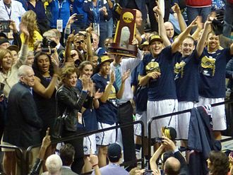 2013–14 Connecticut Huskies women's basketball team - UConn team with championship trophy 2014, on the floor in Nashville, shortly after winning the game and receiving the Championship trophy.