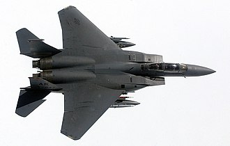 McDonnell Douglas F-15E Strike Eagle - A wing over maneuver displays the clean lines and high-wing design of an F-15E from Elmendorf AFB, Alaska.