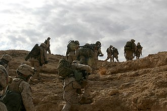 1st Battalion, 2nd Marines - Marines climb a rocky outcrop along the Euphrates River during Operation Koa Canyon in 2006