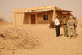 US Army 51765 Soldiers from 2nd Brigade Combat Team, 1st Cavalry Division, talk to the Mukhtar of Chemin, Iraq, as they stand outside of the village's old school during an inspection Sept. 8. A new school is being.jpg