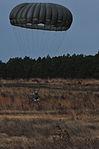 US Army paratrooper landing 141208-A-QW291-197.jpg