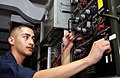 US Navy 020902-N-4953E-005 Aviation Electrician conducts a temperature controller test set for a cabin sensor aboard USS Harry S. Truman (CVN 75).jpg