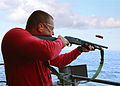 US Navy 021108-N-6020P-001 Sailor fires twelve- gauge shotgun during trainin aboard ship.jpg
