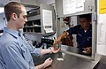 US Navy 021206-N-9964S-002 Airman Jonathan Moody receives money for stamps in the post office.jpg