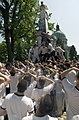 US Navy 030519-N-5319A-011 United States Naval Academy Freshman attempt climbing the Herndon Monument, a 21-foot gray obelisk covered in more than 200 pounds of lard.jpg
