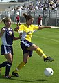 US Navy 030907-N-9693M-002 Navy forward Stacy Finley controls the ball while under pressure from Drexel midfielder Casey Miller during a soccer game at the U.S. Naval Academy's Glenn Warner Soccer Facility.jpg