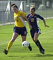 US Navy 030907-N-9693M-007 Navy midfielder Ariana Downs tries to steal the ball from Drexler defender Jenna Carson during a soccer game at the U.S. Naval Academy's Glenn Warner Soccer Facility.jpg