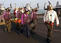 US Navy 041210-N-2984R-012 Sailors help carry an injured shipmate to an MH-53E Sea Dragon assigned to the Blackhawks of Helicopter Mine Countermeasures One Five (HM-15) aboard the Nimitz-class aircraft carrier USS Harry S. Trum.jpg