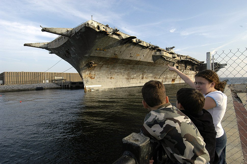 US Navy 050111-N-5328N-015 On lookers watch as the 888-foot decommission aircraft carrier Oriskany arrives in Pensacola on Dec. 20, 2004 from Corpus Christi, Texas