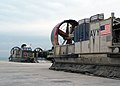 US Navy 050215-N-6581H-002 Landing Craft, Air Cushion (LCAC) vehicles, assigned to Assault Craft Unit Five (ACU-5), off load Marines and equipment on board Kuwait Naval Base to participate in a training exercise.jpg