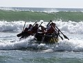 US Navy 050316-N-3953L-258 U.S. Olympic Team triathletes maneuver a rubber raft in the surf during a day of training with Navy SEALs (Sea, Air, Land) on board Naval Special Warfare Center, San Diego, Calif.jpg