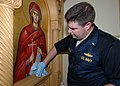 US Navy 050915-N-6204K-069 U.S. Navy Chaplain Lt. Michael Hendrickson helps clean up the Greek Orthodox Church of New Orleans after Hurricane Katrina.jpg