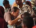 US Navy 051109-F-8425S-256 U.S. Navy Hospital Corpsman Miami Gollyhorn looks into the ears of a local child with an otoscope during a medical examination in Gode, Ethiopia.jpg