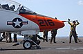 US Navy 060430-N-6484E-008 Flight deck personnel prepare a T-45A Goshawk trainer jet before it launches from the flight deck aboard the Nimitz-class aircraft carrier USS Theodore Roosevelt (CVN 71).jpg