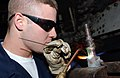 US Navy 061021-N-0685C-005 Hull Maintenance Technician Fireman James Sawyer of Sulphur Springs, Texas, brazes a fitting pipe from a heat exchange aboard USS Theodore Roosevelt (CVN 71).jpg