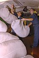 US Navy 070129-N-7780S-028 Airman Ronald Covarrubias and Airman Jason Taylor throw bags of laundry into a pile waiting to be cleaned in the ships laundry aboard Nimitz-class aircraft carrier USS John C. Stennis (CVN 74).jpg