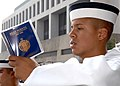 US Navy 070627-N-1026O-002 A plebe, or freshman, from the U.S. Naval Academy Class of 2011 studies a copy of Reef Points, a thorough introduction to the Navy.jpg