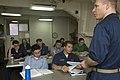 US Navy 070809-N-5387K-003 he Ship's Psychologist, Lt. Justin D'Arienzo teaches a psychology class aboard the USS Kitty Hawk (CV 63).jpg